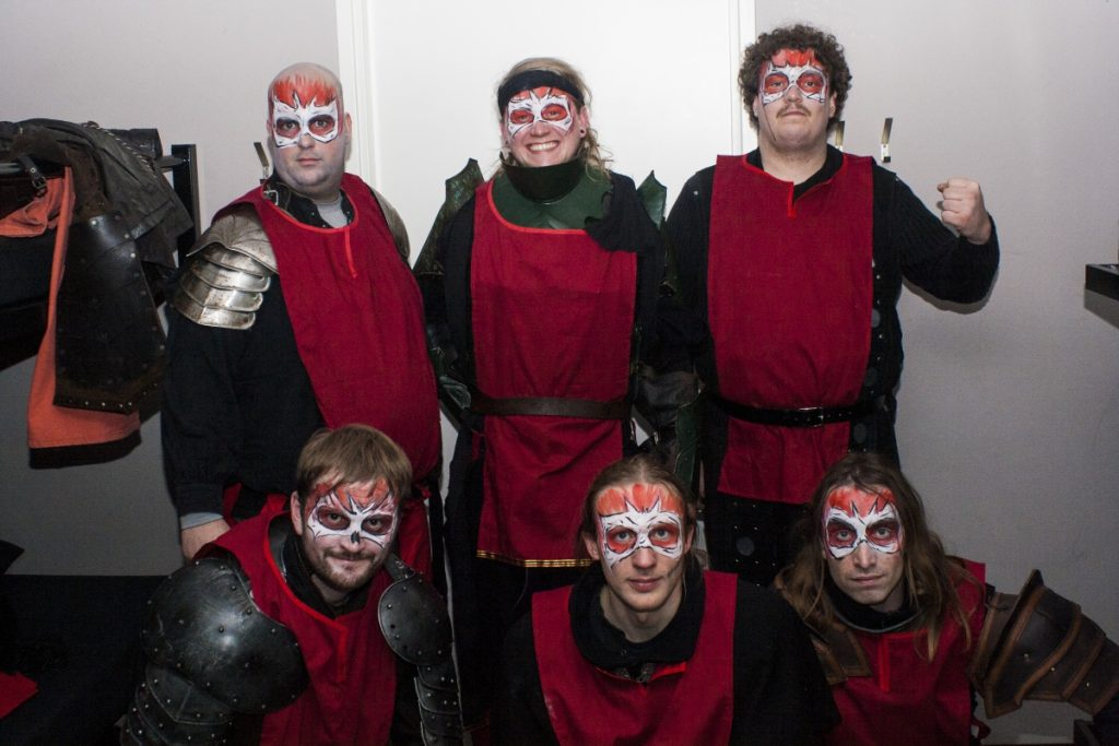 Groep evil figuranten